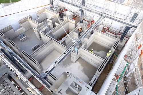 Fastest 3D construction printer tackles 3-story apartment in Germany